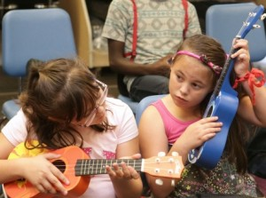 Young students test out their Amahi ukuleles.